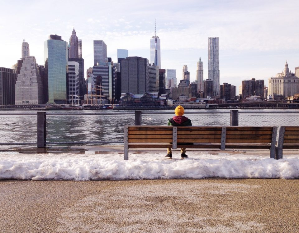 Man sitting and looking at New York City